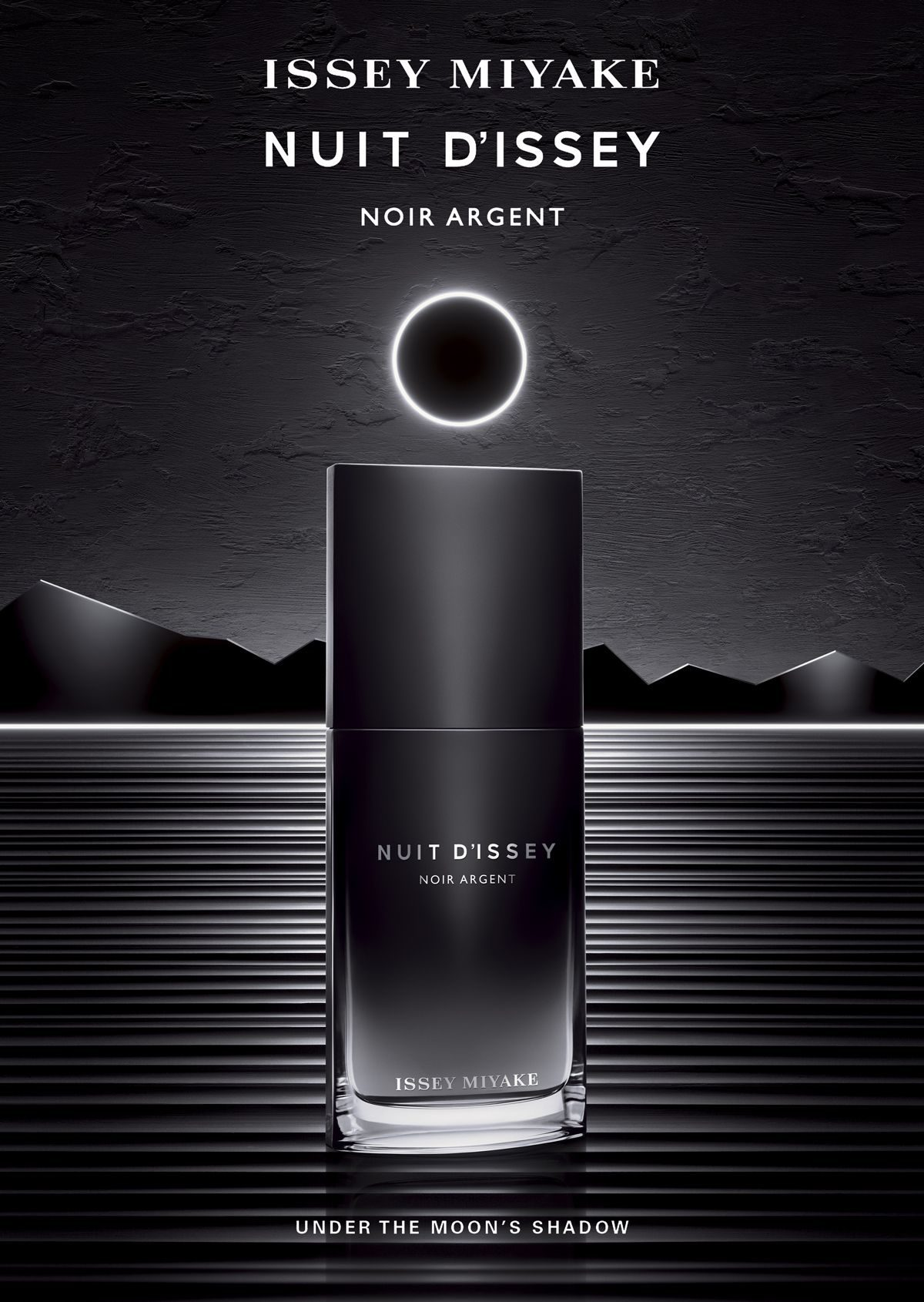 Issey Miyake Nuit D'Issey Noir Argent  The fashion house of Issey Miyake delights its wearers with a new tempting and exquisite fragrance for men, Nuit D'Issey Noir Argent. 'Under the moon's shadow' comes the new perfume's slogan thus inspiring an intense, long-lasting and an evening masculine perfume for manly-man. Issey Miyake Nuit D'Issey Noir Argent is described as a fresh/woody intense fragrance with a nice and arresting aroma to beckon a woman's heart. Created by famous perfumer Dominique Ropion and marked by the Shiseido Group, the new fragrance will constantly seduce with its lingering sensuality.    Nuit D'Issey Noir Argent opens with spice notes of pink and black pepper, nutmeg, leather along with woody ingredients of patchouli, wood, myrrh, oriental saffron,and vetiver. Nuit D'Issey Noir Argent follows the original version Nuit D'Issey launched in 2014 and promises to elude the same radiance, elegant aroma as the original fragrance and not to dissatisfy.  Issey Miyake Nuit D'Issey Noir Argent is available in 100ml Eau de Toilette.
